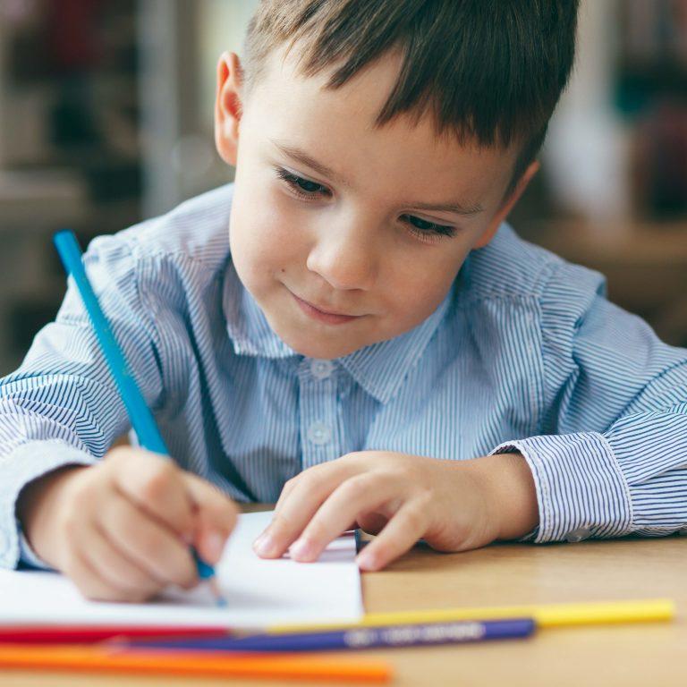 preschool boy writing