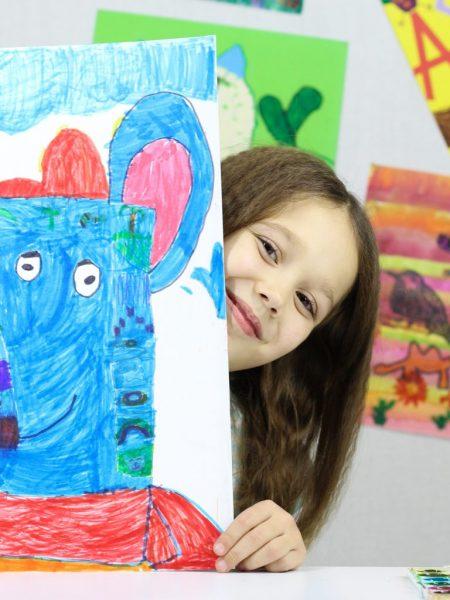 grade school girl with artwork